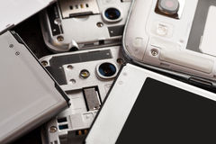 Disassembled cell phone with visible parts inside Royalty Free Stock Photo