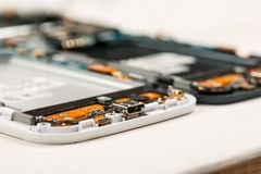 Disassembled cell phones and other gadgets in repair shop.  stock photo