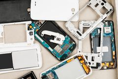 Disassembled cell phones and other gadgets in repair shop.  stock photos