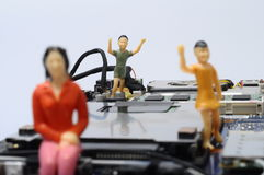 Disassembled computer components and people  figurines Stock Photography