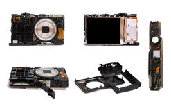 Disassembled digital camera from different angles. Details of the broken camera. Royalty Free Stock Photos