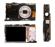Disassembled digital camera from different angles. Stock Photography