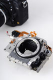 Disassembled dslr camera. On white background. Made of plastic with metal bayonet stock image