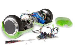 Disassembled Electric Skateboard with Screwdriver Stock Photo