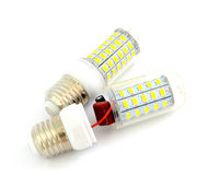 Disassembled energy saving LED light bulb on a white background. Energy saving LED light bulb on a white background Royalty Free Stock Photos