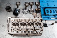 Disassembled engine block is on the table. the mechanic opened the locking valve mechanism. Motor capital repair stock image