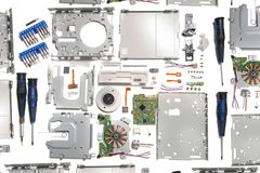 Disassembled floppy disk drive. Parts isolated on a white background Stock Photo