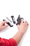 Disassembled gun and hands,  Royalty Free Stock Photo
