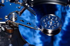 The disassembled hard disk. Of the computer on a dark blue background Royalty Free Stock Photo