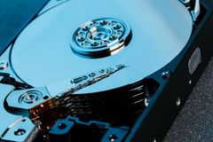 Disassembled hard drive from the computer, hdd with mirror effect. Opened hard drive from the computer hdd with mirror effects. Pa royalty free stock photo