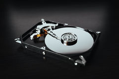 Disassembled hard drive from the computer (hdd) with mirror effects. Part of computer (pc, laptop) Royalty Free Stock Photography