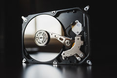 Disassembled hard drive from the computer (hdd) with mirror effects. Part of computer (pc, laptop) stock photo