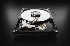 Disassembled hard drive from the computer (hdd) with mirror effects. Part of computer (pc, laptop) stock photography