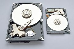 Disassembled hard drive for computer and laptop on white background. stock image