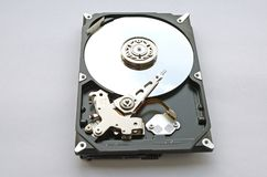 Disassembled hard drive for computer on white background Royalty Free Stock Image