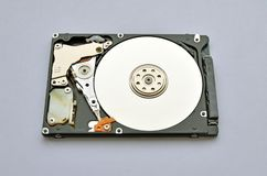 Disassembled hard drive for laptop on white background. royalty free stock photography