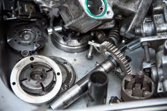 Disassembled mechanical high-pressure diesel pump. Components of the mechanism. Service of maintenance of diesel. Close up The disassembled mechanical high royalty free stock photo