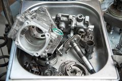 Disassembled mechanical high-pressure diesel pump. Components of the mechanism. Service of maintenance of diesel. Close up The disassembled mechanical high stock images