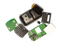 Disassembled mobile phone parts stock photo