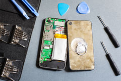 Disassembled mobile phone with repair tools. Workshop Tool Repair Service Device Electronics Damage Maintenance Concept Stock Images