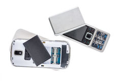 Disassembled old mobile phone isolated on white background. Stock Photos