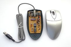 Disassembled optical computer mouse on white background Royalty Free Stock Photos