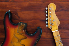 Disassembled into parts stylish vintage guitar. Art background. Royalty Free Stock Photos