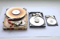 Disassembled Rare hard drive. Interface MFM/ST 412 form factor of 5.25 and sata 3.5 and 2.5 hard drives form factor.  Royalty Free Stock Images