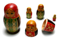Disassembled russian matreshka toys. Isolated on white background Royalty Free Stock Images