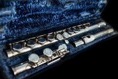 Transverse flute in its case. A disassembled silver transverse flute organized in its case Royalty Free Stock Photography
