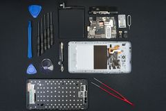 The disassembled smartphone with the removed screen stock photography