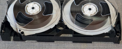 Disassembled VHS cassette components in the background Stock Photography