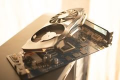 Disassembled video card of a personal desktop computer close-up on the body of a personal desktop computer royalty free stock image