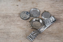 Disassembled watch lies on wooden table. Close up photo Royalty Free Stock Images