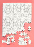 Disassembled white puzzle Royalty Free Stock Images
