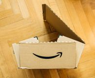 Disassembling Amazon prime cardboard box. PARIS, FRANCE - FEB 21, 2018: Disassembling Amazon prime cardboard box - view from above stock images