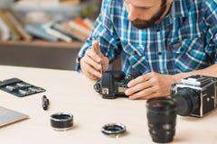 Disassembling of photo camera, close-up stock images