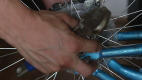 Disassembly bicycle wheel. Unscrewing , in garage stock video footage