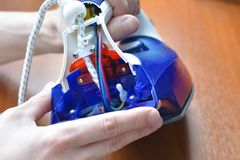Disassembly and repair of electric iron close-up. royalty free stock photography