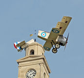 Disaster at airshow. Photo of disaster at airshow as WW1 sopwith camel triplane hits top of the clock tower at herne bay town kent during summer airshow of 2015 Royalty Free Stock Photography