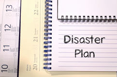 Disaster plan text concept. Write on notebook Royalty Free Stock Photo