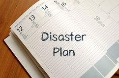 Disaster plan write on notebook. Disaster plan text concept write on notebook Stock Photography