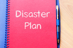 Disaster plan write on notebook. Disaster plan text concept write on notebook with pen Royalty Free Stock Photo