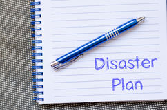 Disaster plan write on notebook. Disaster plan text concept write on notebook with pen Royalty Free Stock Photography