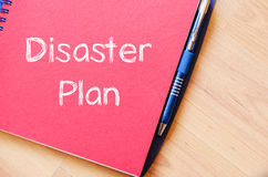 Disaster plan write on notebook. Disaster plan text concept write on notebook with pen Stock Image