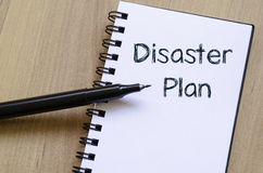 Disaster plan write on notebook. Disaster plan text concept write on notebook with pen Stock Photo
