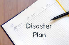 Disaster plan write on notebook. Disaster plan text concept write on notebook with pen Royalty Free Stock Image