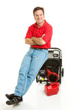 Disaster Preparedness - Ready. Confident man with his electric generator is ready for the storm.  Isolated on white Stock Photo