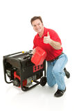 Disaster Preparedness - Thumbs Up. Man fueling his portable emergency generator gives thumbs up sign.  Isolated on white Stock Photo