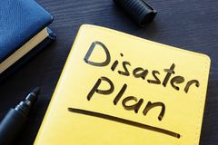 Disaster recovery plan written on a yellow note. royalty free stock images
